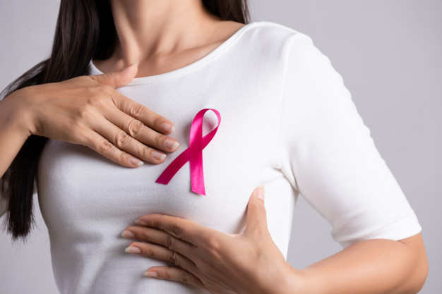 breast cancer awareness with pink ribbon on chest